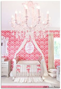 Designed by  - Featuring flocked damask wallpaper and an amazing antique silver crib.