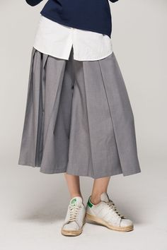 Grey pleated culottes, white shirt, black sweater + sneakers