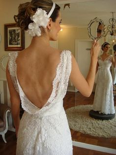 Beautiful back and amazing hair with flowers and headband. LOVE the look!
