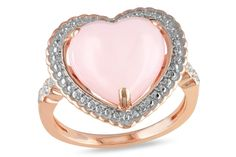 This lovely heart ring features a heart cabochon-cut pink opal center stone with accenting diamonds set in 18 karat rose plated silver. This ring glimmers with a highly polished finish.