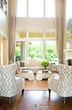 Cheers to the power of draperies! I always tell my clients the investment is worthwhile. As it may seem unnecessary, its often the best way to soften and add interest to a room. It's especially good for vaulted spaces!
