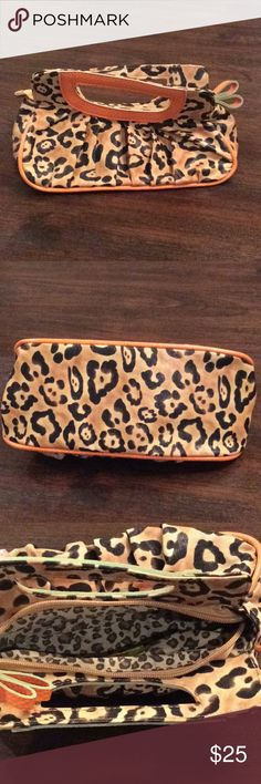 Adorable leopard clutch purse Adorable leopard clutch purse. Purchased from boutique. Never used! Jazzd Bags Clutches & Wristlets