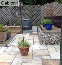 log and stone filled gabions in North Yorkshire garden http://www.gabion1.co.uk