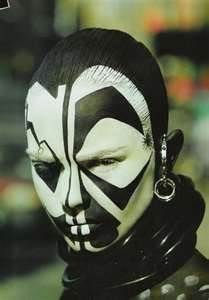 This is a traditional style of African face paint. I like the contrast between the black and white tone.