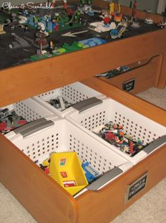 Love the baskets to separate Legos by color... Great post on Lego organization - tons of ideas!!