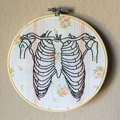 Rib cage illustration hand embroidered on vintage floral fabric, macabre 6 inch hoop hand embroidery wall art, bones, anatomy