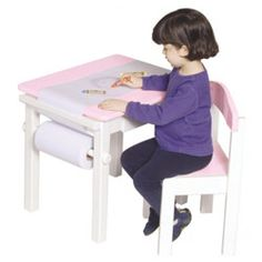 Pink Art Table and Chair Set - Help your daughter develop important skills with this sturdy hardwood table and chair set that is idea for painting, drawing and coloring. A clean white finish with pretty pink accents will delight your little girl.