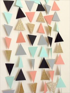 This listing is for geometric triangles garland made from cardstock in coral, mint, gold, grey, and black. This garland is carefully hand-made