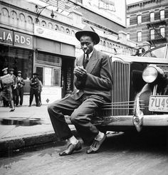 Baseball player Satchel Paige, looking dapper, Harlem, 1941. Photograph by George Strock.