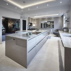 SieMatic Classic kitchen in Agate Grey gloss finish, Corian Sagebrush worktops and dining table, Miele and Bora appliances, light stone. Modern Kitchen Cabinets, Kitchen Tiles, Kitchen Layout, Kitchen Flooring, Kitchen Interior, Kitchen Furniture, Kitchen Appliances, Home Design, Luxury Kitchen Design
