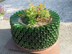beautiful garden containers made from wine bottles...