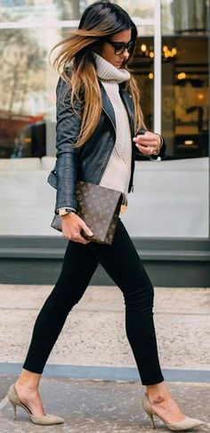 A leather jacket, knit turtleneck and tan pumps make for a perfect fall outfit!