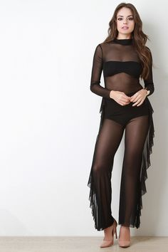 3775cad060a5 This daring jumpsuit features a semi-sheer mesh fabric