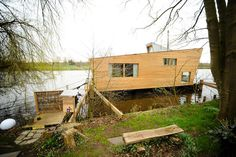 Schwimmhaus by studio Confused Direction is a green house boat.