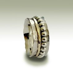 Sterling silver hammered band with silver and gold door artisanlook, $140,00