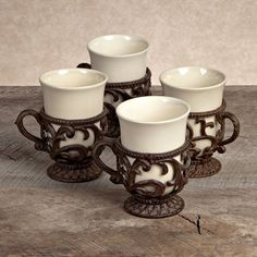 Have to have it. GG Collection  Ceramic Cups with Metal Holders - Cream - Set of 4 - $128 @hayneedle.com