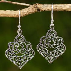 Sterling silver tendrils entwine arabesques to become beautiful earrings. From Wadarat Supasirisuk in Thailand, these elegant earrings are crafted by hand.