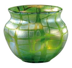 LOETZ ATTRIBUTED TO    Blown glass vase paunchy body battered and flared neck decorated with geometric patterns on blue green iridescent. To 1900. H: 13 cm
