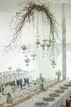 Wooden branch wedding arch to hang flowers or lights off above tables, rustics / http://www.deerpearlflowers.com/twigs-and-branches-wedding-ideas/