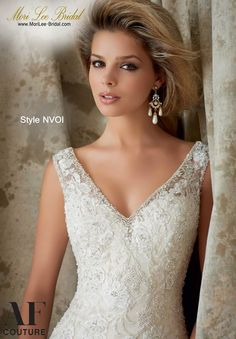 Style NVOI CRYSTAL BEADED EMBROIDERY COMBINED WITH VENICE LACE ON NET Available in White, Ivory, Light Gold Precio: $8.572.850 Pesos Colombianos Precio: $ 3.896.00 Dólares Americanos