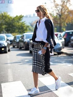 Pair a button-down shirt with a draped leather jacket, tweed pencil skirt, and sneakers