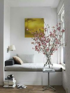 Martha Stewart Living Reading Nook/Remodelista The addition of flowering branches brings nature inside for this window seat inspired reading nook! Decoration Inspiration, Interior Inspiration, Interior Ideas, Decor Ideas, Decorating Ideas, Design Inspiration, Corner Decorating, Summer Decorating, Design Ideas