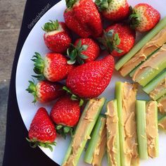 celery with peanut butter + fresh strawberries .. a delicious snack from the past ✿