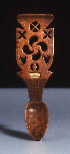 Lovespoon, 19th century, Very similar design carved into a wooden door in Galiza, Spain