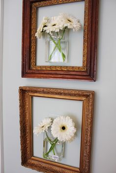 Hang mounted vases with real flowers inside empty picture frames. Beautiful!