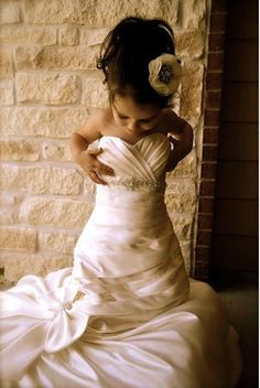 I'd have to do this with Lyla, take a picture of your flower girl in your wedding dress, give it to her on her special day.