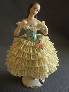 This gorgeous Dresden Lace figurine, circa portrays a stunning ballerina attired in an off-the shoulder gown with medium length skirt composed Dresden Porcelain, Fine Porcelain, Porcelain Ceramics, Glass Figurines, Collectible Figurines, Ballerina Figurines, Ceramic Animals, Porcelain Jewelry, China Painting