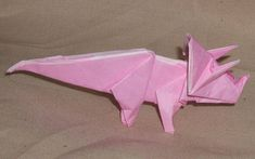 This paper craft is anOrigami Triceratops, designed byDonyaQuick. You can download this step-by-step tutorial here:Step-by-step Origami Triceratops Free