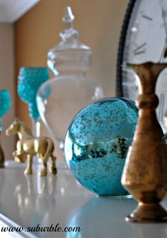 "Suburble: Livening Up The ""Mantel-scape"" - Use a gazing ball as a focal point on the mantel."