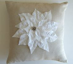 I have seen many versions of this knock-off Pottery Barn Poinsettia pillow.  This is one of my favorites.  (How to tutorial included.)