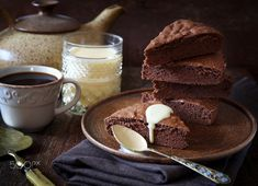 Chocolate cake. Genoise with English cream and cup of coffee - Chocolate cake. Genoise with English cream and cup of coffee. Rustic style