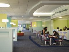 Modular carpet tiles in several patterns add a hospitality-like aesthetic to the waiting area of the hematology and oncology clinic at Dodson Clinic at Cook Children's. Credit: Steve Hall © Hendrich Blessing