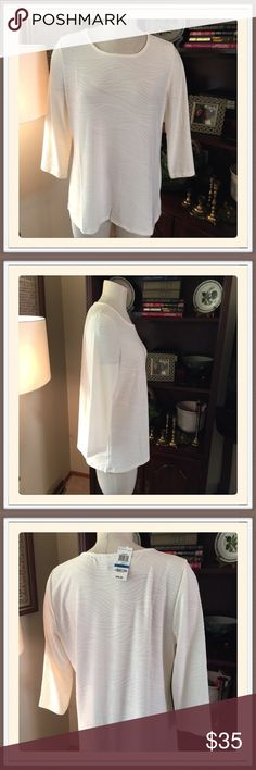 """Jacquard Tunic By JM.    Macy's This is eggshell measuring 21"""" from armhole to armhole and 27"""" length from top of shoulder to hem. Fabric is 92% poly and 8% spandex for machine wash. Great for any season with 19"""" sleeves.  From Macy's🎀🎀 JM Tops Tunics"""