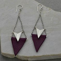 Dramatic, angular earrings, mixing metal and leather, for an edgy look and feel. These pretty, angled chevron links add a three-dimensional aspect, while the leather adds a layered look, but still makes these earring light and easy to wear. Customize with whatever color leather fits your palette! http://www.ninadesigns.com/jewelry_design_ideas/leather_chevron.html