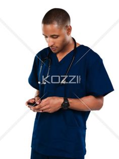 male nurse with phone - Shot of a male nurse in blue scrubs isolated on white.  Model: Kareem Duhaney