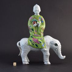 An unusual Chinese export porcelain Famille model of an Immortal riding a Elephant, Qianlong period c.1750-1770.