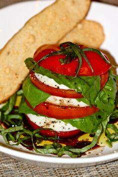 Caprese Salad, fresh tomatoes, fresh mozarella, basil, olive oil and balsamic, I use a balsamic glaze (trader joes)