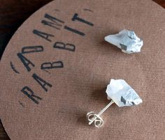 Unique earrings made from two small pieces of quartz, silver paint, and metal earring posts. Large enough to make a statement but not heavy. A funky addition to any outfit. Quartz is a stone of clarit