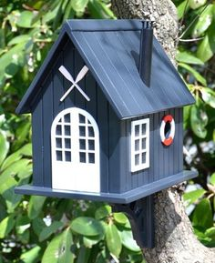 Birdhouse Design Ideas if you like the more modern design of houses then youll love this little birdhouse Boat House Birdhouse