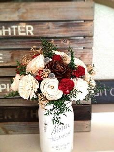 Striking winter wedding floral centerpiece.  Rustic canning jar. Curious Crafts- Forever Floral & Decor