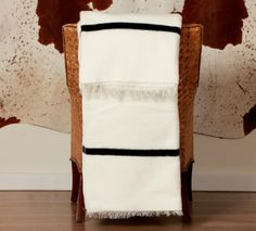 This dazzlingly bright white blanket with a striking black stripe (top and bottom) has fringed edges and is used to mark significant traditional occasions in the Xhosa culture. Xhosa, Black Stripes, Stripe Top, African Fashion, African Style, Ladder Decor, Weaving, Culture, Traditional