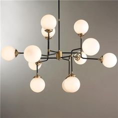 This chandelier is incredibly stylish and architecturally inspired. Its airy frame maintains a refined look while the 12 globe-style lights provide ample lighting. Choose from Antique Brass with White glass or Polished Nickel with Clear glass. Mid Century Modern Chandelier, Mid Century Modern Lighting, Contemporary Chandelier, Mid Century Lamps, 18th Century, Living Room Light Fixtures, Modern Light Fixtures, Living Room Lighting, Kitchen Lighting