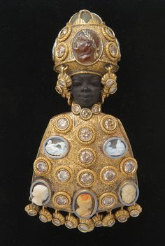 A Codognato Blackamoor brooch, hand-carved from precious metals and ebony, and set with diamonds.