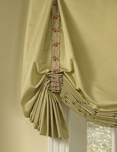 Tape inside the pleat... love! It is all in the details.- Robert Allen