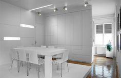 Minimalist partition design between the dining area and kitchen