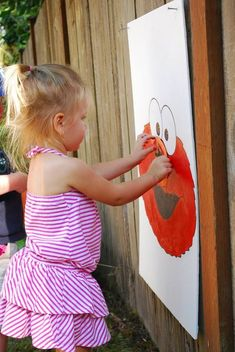 Pin the nose on Elmo.
